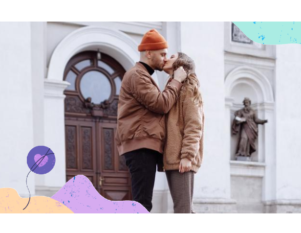 Christian couple kiss in front of church