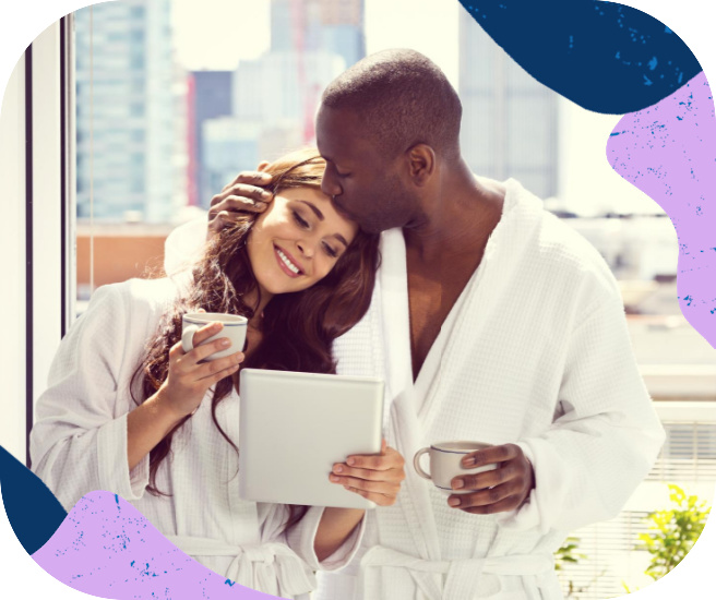 Elite couple in hotel robes